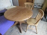 Pine, extendable, round, pedestal dining table and 6 farmhouse chairs