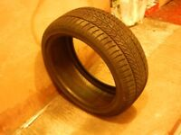 PUNCTURED CAR TYRE FOR USE AS SWING.