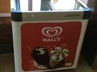 Walls ice cream freezer plus sign and 2 parasols