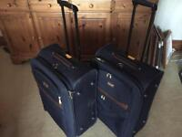 2 navy suitcases (medium size) with brown trim