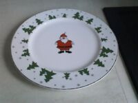 Children's Christmas dinner plates plus a Christmas mug. All in excellent condition. All for £10.