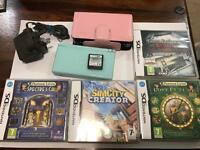 Nintendo DS Lite with accessories and 5 games