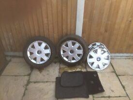 Ford Ka 2x wheels, 6x hub caps, CD player, code and manuals and car mats