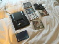 Sony PlayStation 3 with 5 games