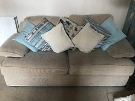 2 beige three seater sofas with cushions