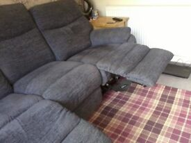 Grey 3 seater sofa with two electric reclining chairs.