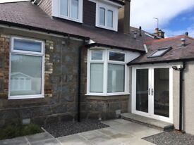Two white upvcs windows with integral blinds plus patio door. Excellent condition £500ono