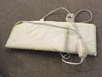 Adjustable white massage bed, heated booties for mani/pedi's and UV nail lamp