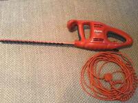 Electric corded flymo hedge trimmer.