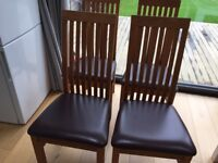 6 beautiful solid Pine wood chairs with leather seats