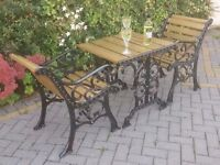 SET OF CAST IRON GARDEN OR PATIO TABLE AND PAIR OF CHAIRS IN BLACK