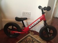 Red Strider balance bike, like new