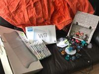 Wii console with Wii fit board and assorted games