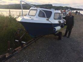 Microlite boat on trailer