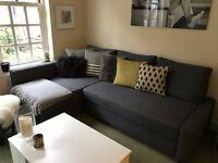 Corner sofa-bed with storage
