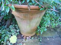 Two huge, most unusual and matching, round terracotta plant pots