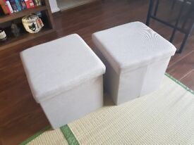 Two beige fabric storage boxes