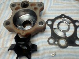 Yamaha 55 AE water pump, impeller, housing and plate.
