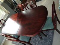Elegant McDonagh dining table and 6 chairs. Seats up to 10.