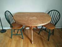 Circular Dining room table with folding sides and 4 chairs