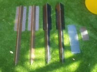 Steel ground stakes for use with wooden sleepers