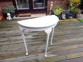 Ornate half round table in grey and white