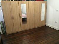3 Door Wardrobe with Mirror Door and shelves and hanging space