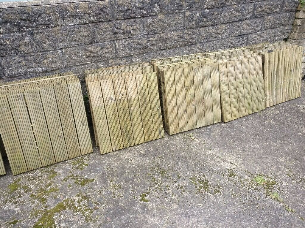 28 Wood Decking Squaresin Penarth, Vale of GlamorganGumtree - 28 decking squares, used, 60 cm x 60 cm (plus three at half size and two at third size). Sound condition though would benefit from a scrub. Current retail price appears to be around £11 to £13 each