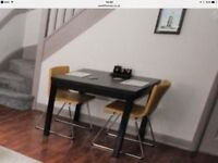 Dining table extending dark brown/walnut colour & 2 gold leather chairs from Ikea