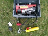 Electric winch and scaffold swing bracket