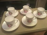 ROYAL WORCESTER SET OF FIVE COFFEE CUPS AND SAUCERS