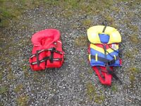 2 toddlers life jackets