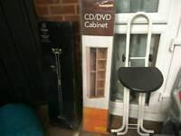 Double lounge lamp, CD rack, ironing stool, child bike seat