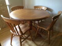 SOLID PINE CIRCULAR TABLE AND FOUR CHAIRS