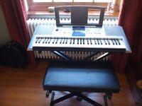 Yamaha Digital Keyboard model PSR-E323 with folding stand and stool