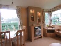 2010 Willerby Granada with site fees toll April 17 & large decking on a beautiful plot
