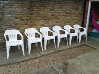 6 Six Plastic garden chairs in white. FREE LOCAL DELIVERY