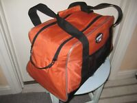 Orange and Black Fabric Travel Bag