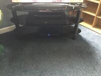 3 Shelf black glass TV stand excellent condition.