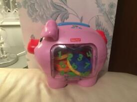 Baby toy fisher price laugh and learn piggy bank