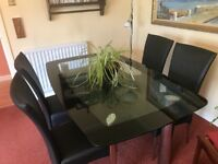 Dining room table - smoked glass with 4 dining room chairs