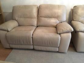 Beautiful cream soft leather reclining two seater sofa