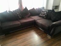 Grey and Black DFS Corner sofa bed.