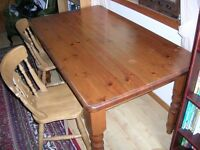 Pine kitchen table and four pine chairs