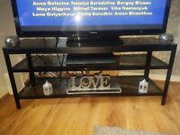 Black glass tv unit from Ikea holds up to 50inch tv excellent condition buyer must collect £30 ono