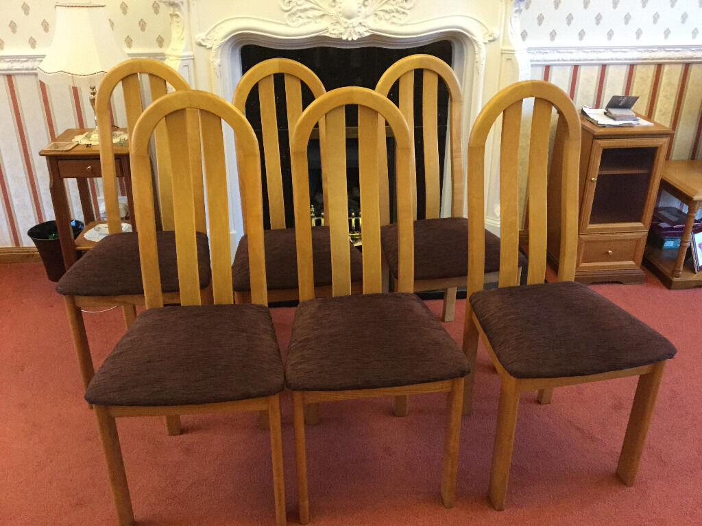 Dining chairs, Oak with brown padded seatset of 6 chairsin Fairmilehead, EdinburghGumtree - Dining chairs, Oak with brown padded seat set of 6 chairs Dining chairs, Oak with brown padded fabric seat set of 6 chairs. In very good condition. Please have a look at the other items I am selling as I am having a clear out