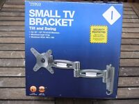 """Tilt and swing small TV bracket to hang on the wall. Suits 10"""" to 23"""" TV's/LCD monitors."""