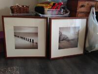 Two serene seaside framed prints
