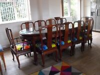 Chinese extending rosewood table, bevelled glass top, 8 chairs. 2 carvers available