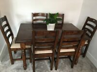 Extendible solid wood table and 6 chairs for sale